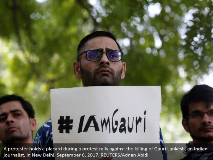 A protester holds a placard during a protest rally against the killing of Gauri Lankesh, an Indian journalist, in New Delhi, September 6, 2017. REUTERS/Adnan Abidi