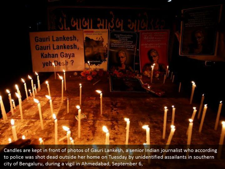 Candles are kept in front of photos of Gauri Lankesh, a senior Indian journalist who according to police was shot dead outside her home on Tuesday by unidentified assailants in southern city of Bengaluru, during a vigil in Ahmedabad, September 6,