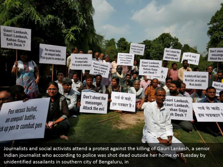 Journalists and social activists attend a protest against the killing of Gauri Lankesh, a senior Indian journalist who according to police was shot dead outside her home on Tuesday by unidentified assailants in southern city of Bengaluru, in