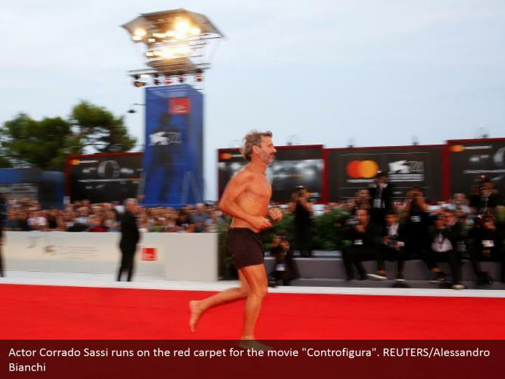 "Actor Corrado Sassi runs on the red carpet for the movie ""Controfigura"". REUTERS/Alessandro Bianchi"