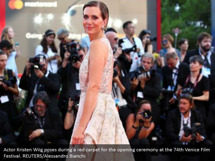 Actor Kristen Wiig poses during a red carpet for the opening ceremony at the 74th Venice Film Festival. REUTERS/Alessandro Bianchi