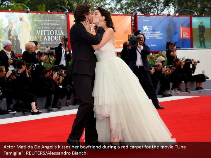 "Actor Matilda De Angelis kisses her boyfriend during a red carpet for the movie ''Una Famiglia"". REUTERS/Alessandro Bianchi"