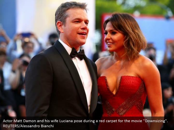 "Actor Matt Damon and his wife Luciana pose during a red carpet for the movie ""Downsizing"". REUTERS/Alessandro Bianchi"