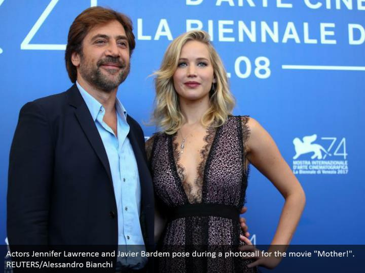 "Actors Jennifer Lawrence and Javier Bardem pose during a photocall for the movie ""Mother!"". REUTERS/Alessandro Bianchi"