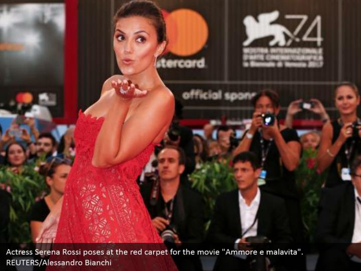 Actress serena rossi poses at the red carpet