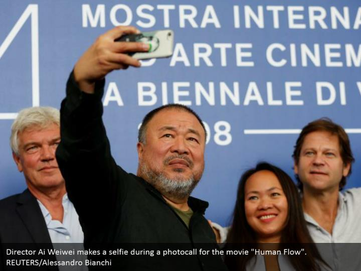 "Director Ai Weiwei makes a selfie during a photocall for the movie ""Human Flow"". REUTERS/Alessandro Bianchi"