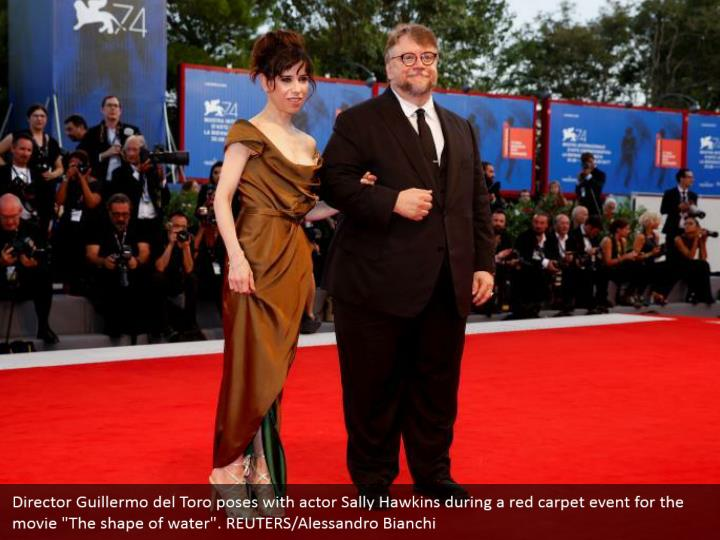 "Director Guillermo del Toro poses with actor Sally Hawkins during a red carpet event for the movie ""The shape of water"". REUTERS/Alessandro Bianchi"