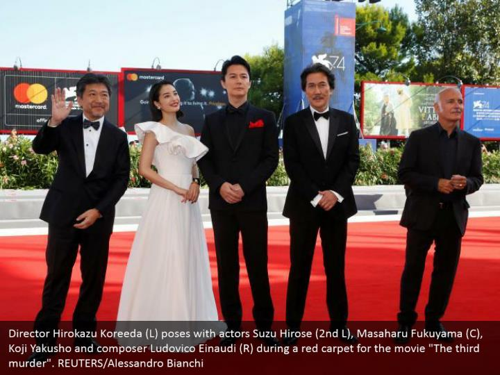 "Director Hirokazu Koreeda (L) poses with actors Suzu Hirose (2nd L), Masaharu Fukuyama (C), Koji Yakusho and composer Ludovico Einaudi (R) during a red carpet for the movie ""The third murder"". REUTERS/Alessandro Bianchi"