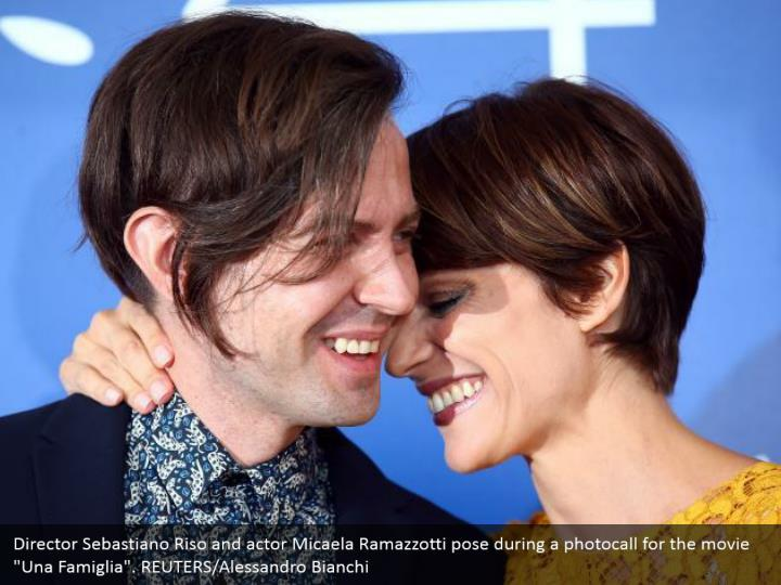 "Director Sebastiano Riso and actor Micaela Ramazzotti pose during a photocall for the movie ""Una Famiglia"". REUTERS/Alessandro Bianchi"