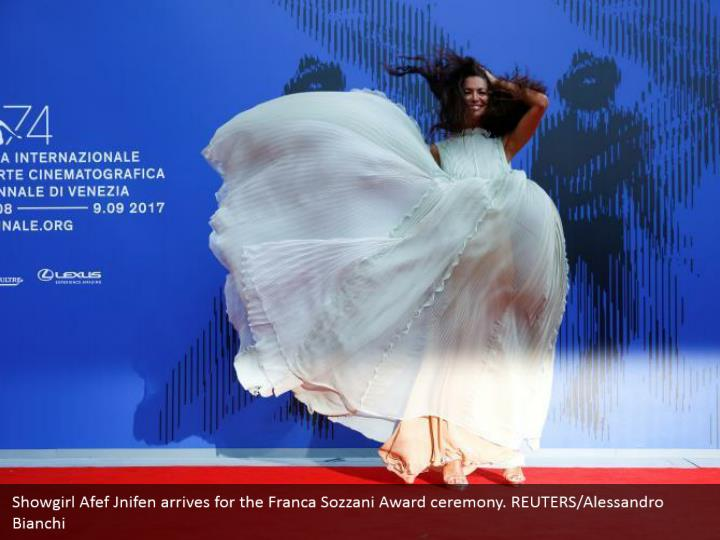Showgirl Afef Jnifen arrives for the Franca Sozzani Award ceremony. REUTERS/Alessandro Bianchi