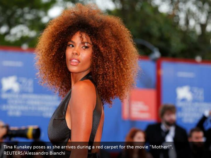 "Tina Kunakey poses as she arrives during a red carpet for the movie ""Mother!"". REUTERS/Alessandro Bianchi"