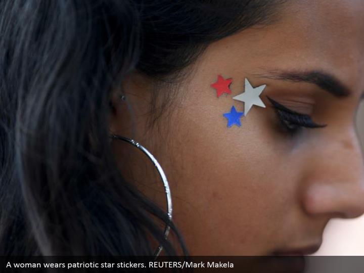 A woman wears patriotic star stickers. REUTERS/Mark Makela