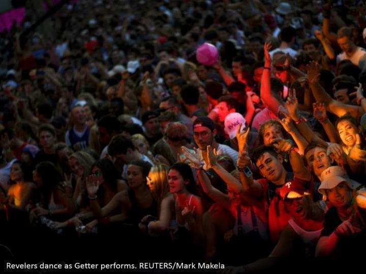 Revelers dance as Getter performs. REUTERS/Mark Makela