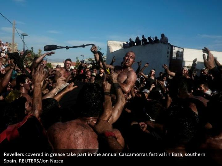 Revellers covered in grease take part in the annual Cascamorras festival in Baza, southern Spain. REUTERS/Jon Nazca