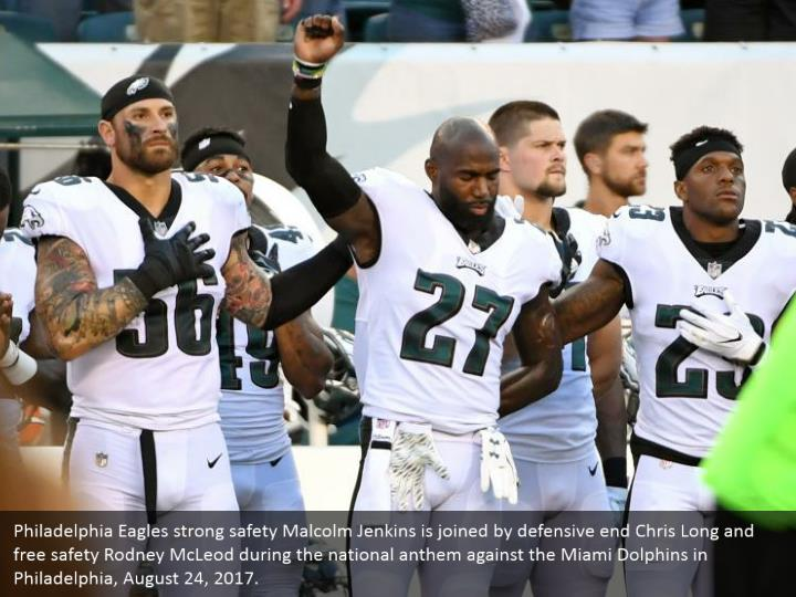 Philadelphia Eagles strong safety Malcolm Jenkins is joined by defensive end Chris Long and free safety Rodney McLeod during the national anthem against the Miami Dolphins in Philadelphia, August 24, 2017.