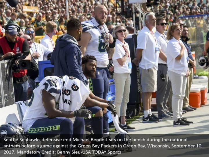Seattle Seahawks defensive end Michael Bennett sits on the bench during the national anthem before a game against the Green Bay Packers in Green Bay, Wisconsin, September 10, 2017. Mandatory Credit: Benny Sieu-USA TODAY Sports