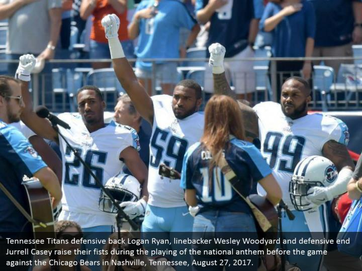 Tennessee Titans defensive back Logan Ryan, linebacker Wesley Woodyard and defensive end Jurrell Casey raise their fists during the playing of the national anthem before the game against the Chicago Bears in Nashville, Tennessee, August 27, 2017.