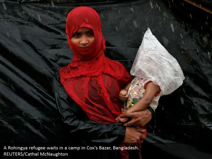 A Rohingya refugee waits in a camp in Cox's Bazar, Bangladesh.  REUTERS/Cathal McNaughton