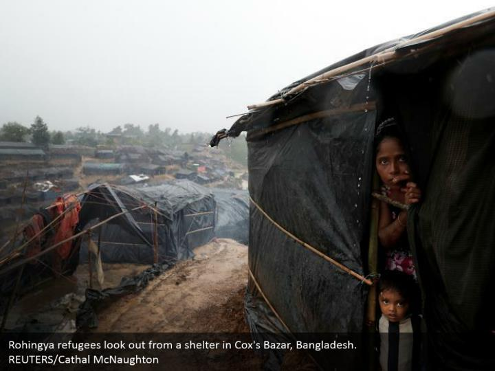 Rohingya refugees look out from a shelter in Cox's Bazar, Bangladesh.  REUTERS/Cathal McNaughton