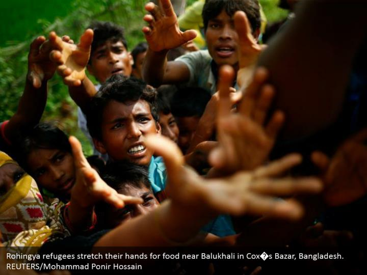 Rohingya refugees stretch their hands for food near Balukhali in Cox�s Bazar, Bangladesh.  REUTERS/Mohammad Ponir Hossain