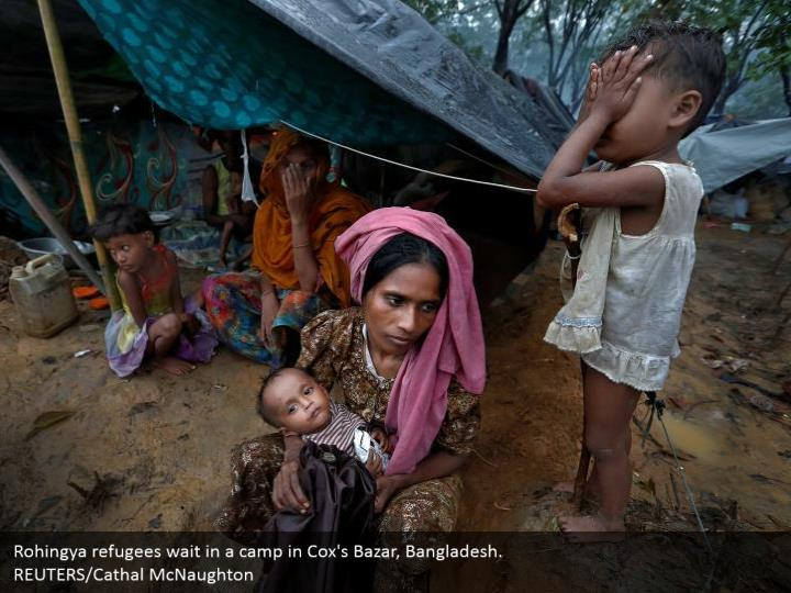 Rohingya refugees wait in a camp in Cox's Bazar, Bangladesh.  REUTERS/Cathal McNaughton