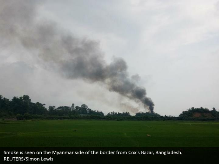 Smoke is seen on the Myanmar side of the border from Cox's Bazar, Bangladesh. REUTERS/Simon Lewis