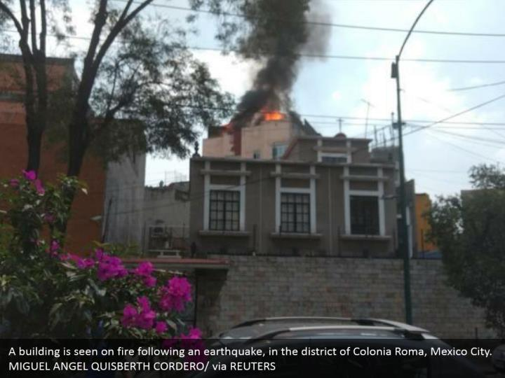 A building is seen on fire following an earthquake, in the district of Colonia Roma, Mexico City. MIGUEL ANGEL QUISBERTH CORDERO/ via REUTERS