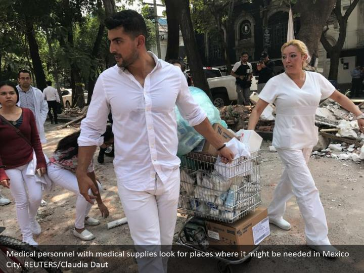 Medical personnel with medical supplies look for places where it might be needed in Mexico City. REUTERS/Claudia Daut