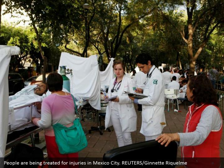 People are being treated for injuries in Mexico City. REUTERS/Ginnette Riquelme