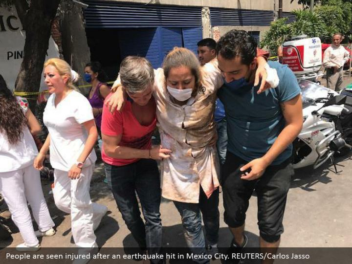 People are seen injured after an earthquake hit in Mexico City. REUTERS/Carlos Jasso