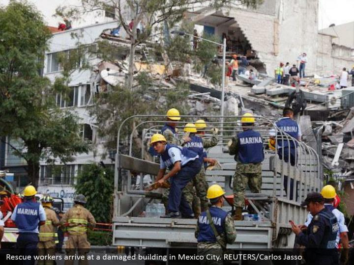 Rescue workers arrive at a damaged building in Mexico City. REUTERS/Carlos Jasso