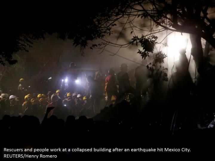 Rescuers and people work at a collapsed building after an earthquake hit Mexico City. REUTERS/Henry Romero
