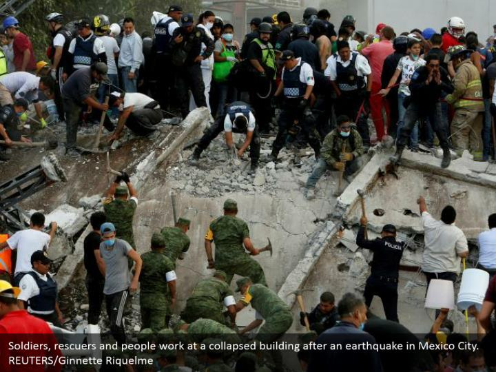 Soldiers, rescuers and people work at a collapsed building after an earthquake in Mexico City.  REUTERS/Ginnette Riquelme
