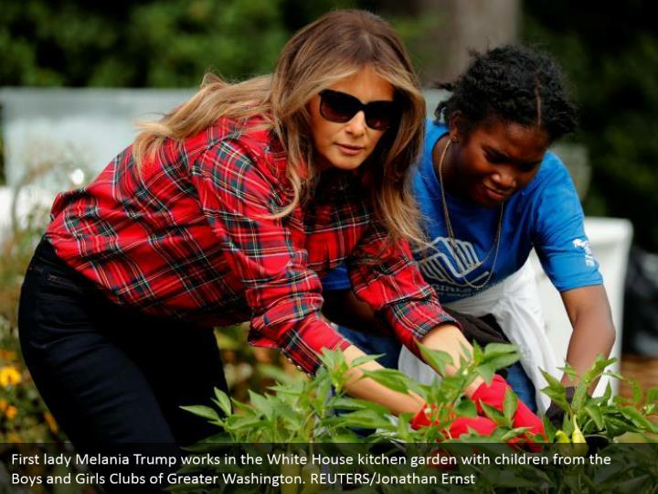 First lady Melania Trump works in the White House kitchen garden with children from the Boys and Girls Clubs of Greater Washington. REUTERS/Jonathan Ernst