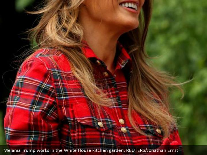 Melania Trump works in the White House kitchen garden. REUTERS/Jonathan Ernst