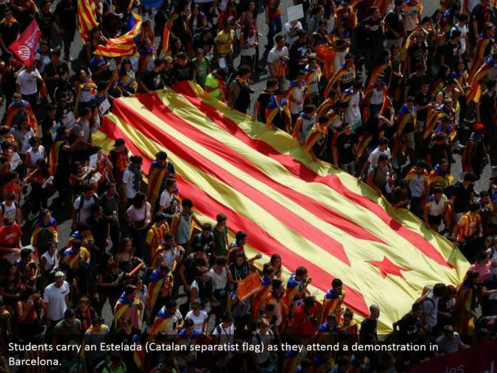 Students carry an Estelada (Catalan separatist flag) as they attend a demonstration in Barcelona.