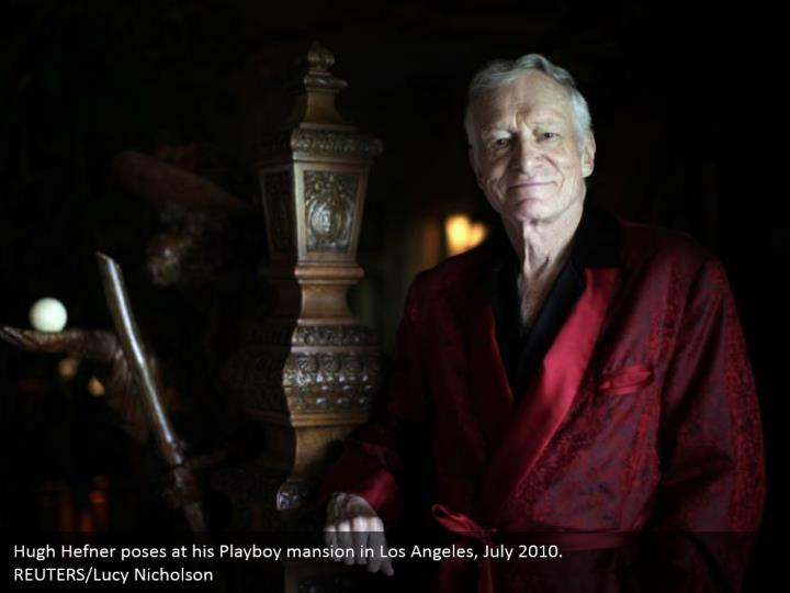 Hugh Hefner poses at his Playboy mansion in Los Angeles, July 2010.  REUTERS/Lucy Nicholson