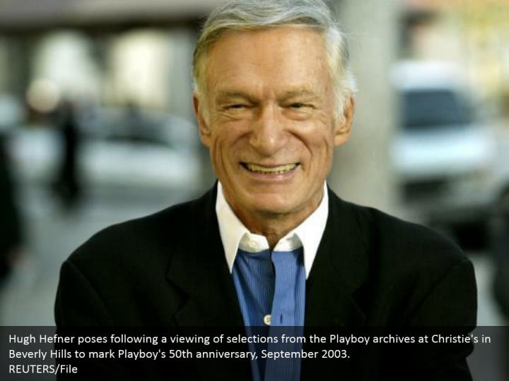 Hugh Hefner poses following a viewing of selections from the Playboy archives at Christie's in Beverly Hills to mark Playboy's 50th anniversary, September 2003.  REUTERS/File