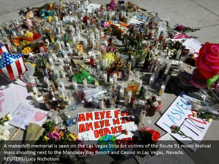 A makeshift memorial is seen on the Las Vegas Strip for victims of the Route 91 music festival mass shooting next to the Mandalay Bay Resort and Casino in Las Vegas, Nevada. REUTERS/Lucy Nicholson