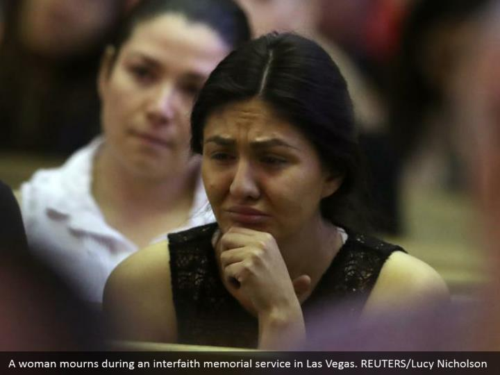 A woman mourns during an interfaith memorial service in Las Vegas. REUTERS/Lucy Nicholson