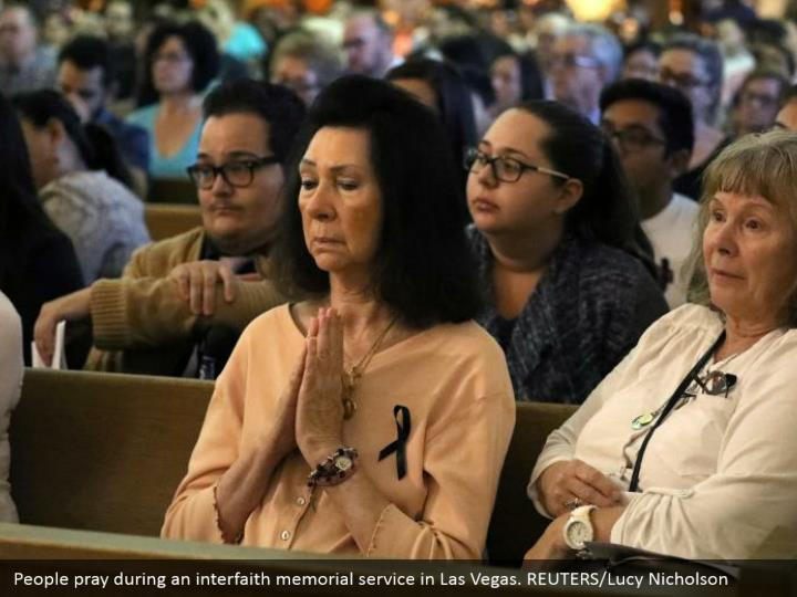 People pray during an interfaith memorial service in Las Vegas. REUTERS/Lucy Nicholson