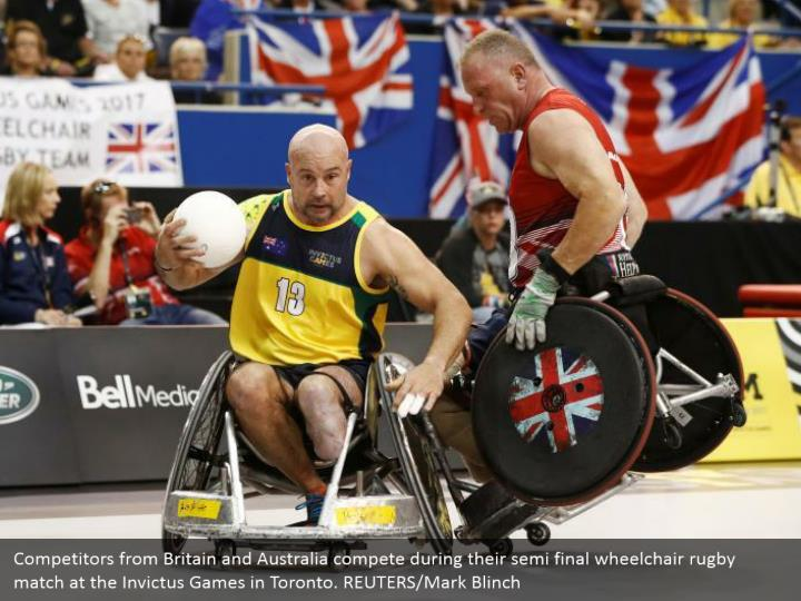 Competitors from Britain and Australia compete during their semi final wheelchair rugby match at the Invictus Games in Toronto. REUTERS/Mark Blinch