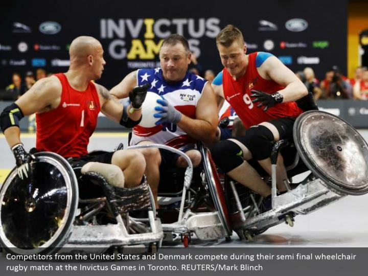Competitors from the United States and Denmark compete during their semi final wheelchair rugby match at the Invictus Games in Toronto. REUTERS/Mark Blinch