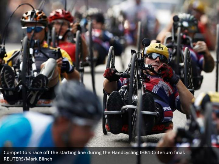 Competitors race off the starting line during the Handcycling IHB1 Criterium final. REUTERS/Mark Blinch