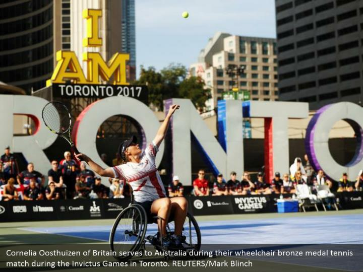 Cornelia Oosthuizen of Britain serves to Australia during their wheelchair bronze medal tennis match during the Invictus Games in Toronto. REUTERS/Mark Blinch