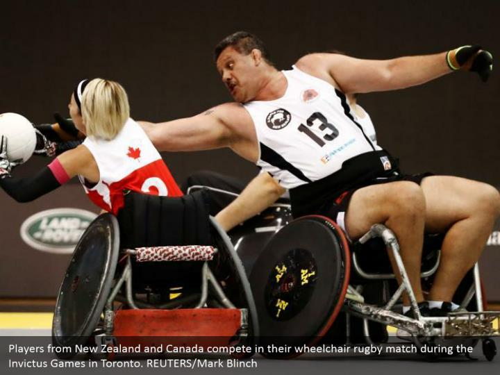 Players from New Zealand and Canada compete in their wheelchair rugby match during the Invictus Games in Toronto. REUTERS/Mark Blinch