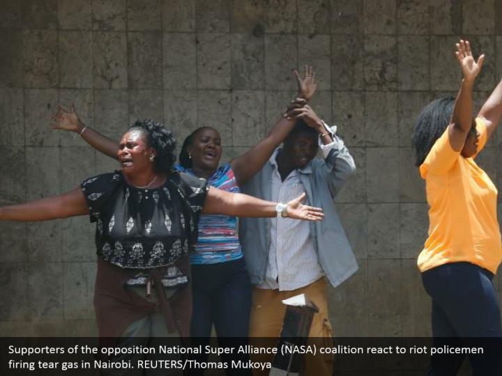 Supporters of the opposition National Super Alliance (NASA) coalition react to riot policemen firing tear gas in Nairobi. REUTERS/Thomas Mukoya