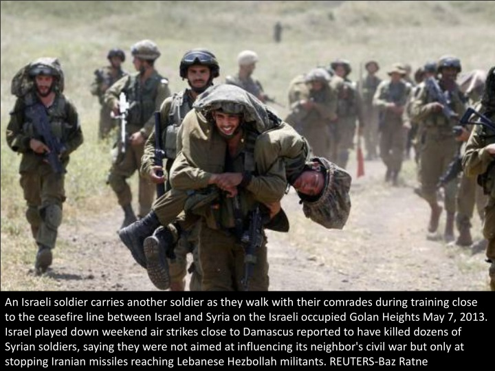 an israeli soldier carries another soldier n.