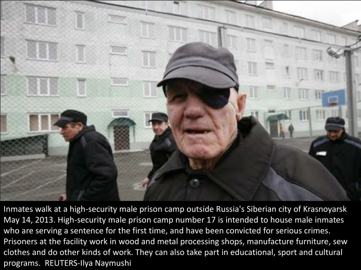 inmates walk at a high security male prison camp n.