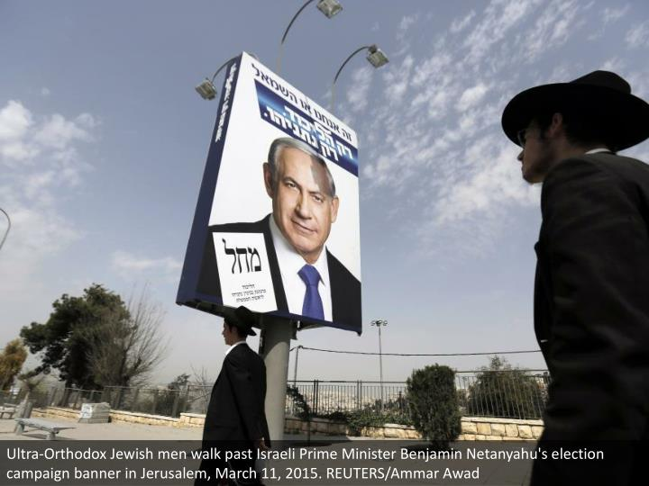 Ultra-Orthodox Jewish men walk past Israeli Prime Minister Benjamin Netanyahu's election campaign banner in Jerusalem, March 11, 2015. REUTERS/Ammar Awad